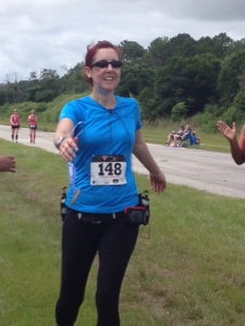 Michelle crossing the finish line